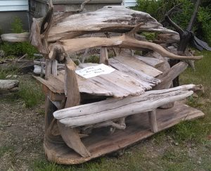 large driftwood bench